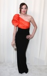 Rose McGowen in Paul Ka with David Webb jewels and a Edie Parker clutch
