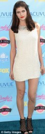 Alexandra Daddario in DvF and Jimmy Choo