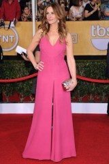 Julia Roberts wore a bespoke jumpsuit by Valentino and carried a Roger Vivier clutch