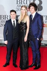 Dan Rothman, Hannah Reid - in Elie Saab - and Dot Major
