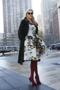 Irina Bass in a Carolina Herrera dress, Oscar de la Renta coat and Charlotte Olympia shoes