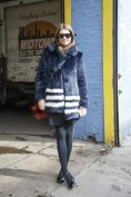 Natalie Massenet in a Shrimps coat with a Fendi bag