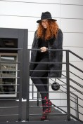 Natasha Zinko in Rick Owens with Charlotte Olympia boots and a Chanel bag