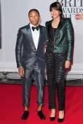 Pharrell - in Lanvin - with his wife Helen Lasichanh